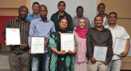Computer literacy group with certificates